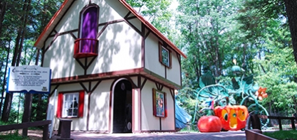 Image of Story Book Lane. The image shoes Cinderellas house with her pumpkin carriage in the background.