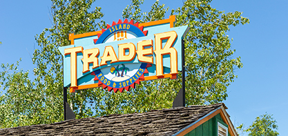Image of the Island trader sign on top of the building