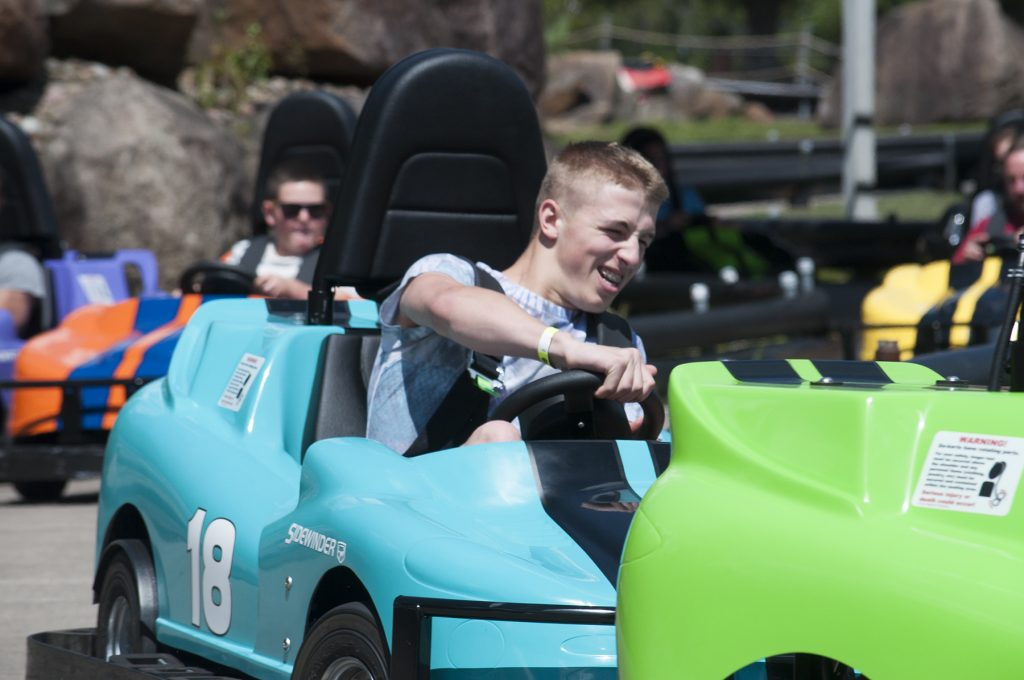 Calypsos Cove Go Carts with a male young adult going around the corner in his blue go cart