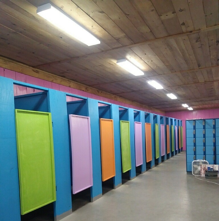 Woman S Bathroom With Green Purple And Orange Doors And