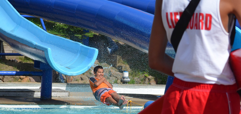 Image of a lifeguard facing a boy going into the water