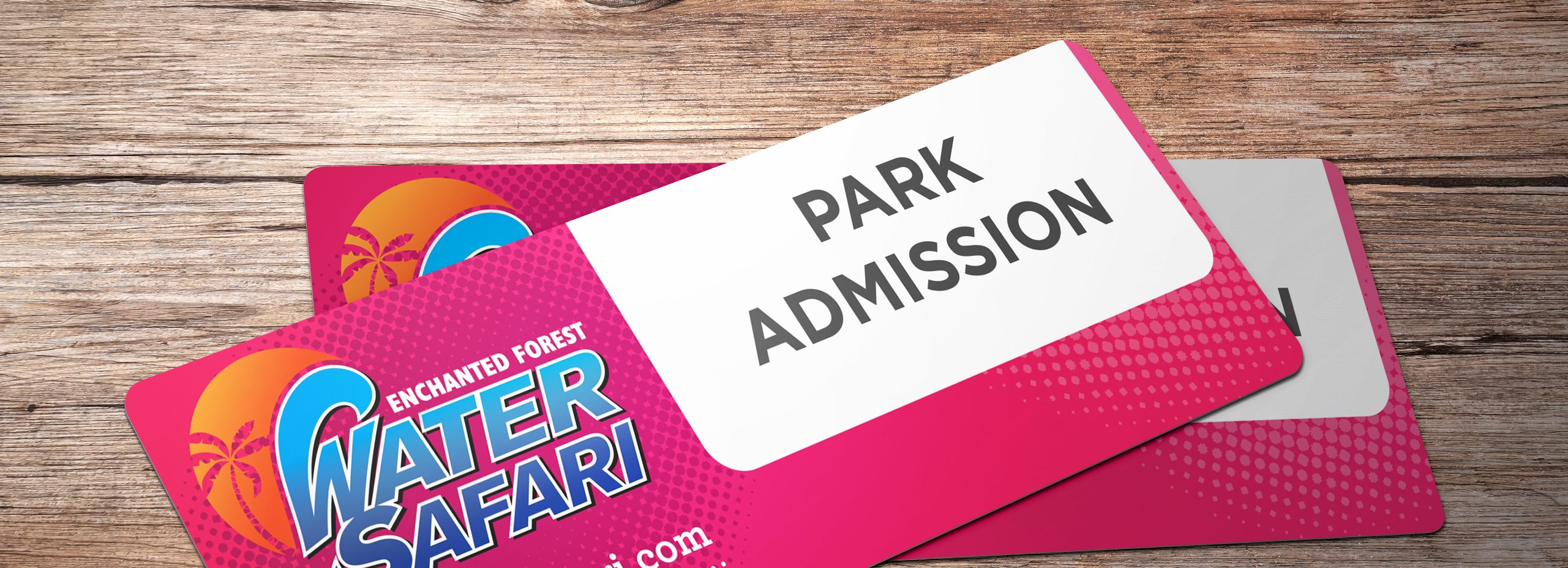 Image that shows the park admission passes. The passes have a bright pink background whit the water safari logo on the left hand side. it has water safari.com written on the bottom and then it says under that, void if resold. No refunds or rain checks.