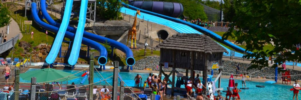 Water rides, pools, and people walking around going on rides