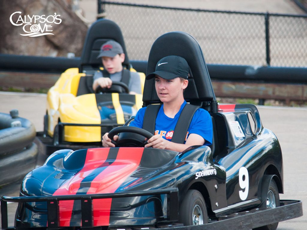 Two boys riding the go-karts at Calypso's Cove.